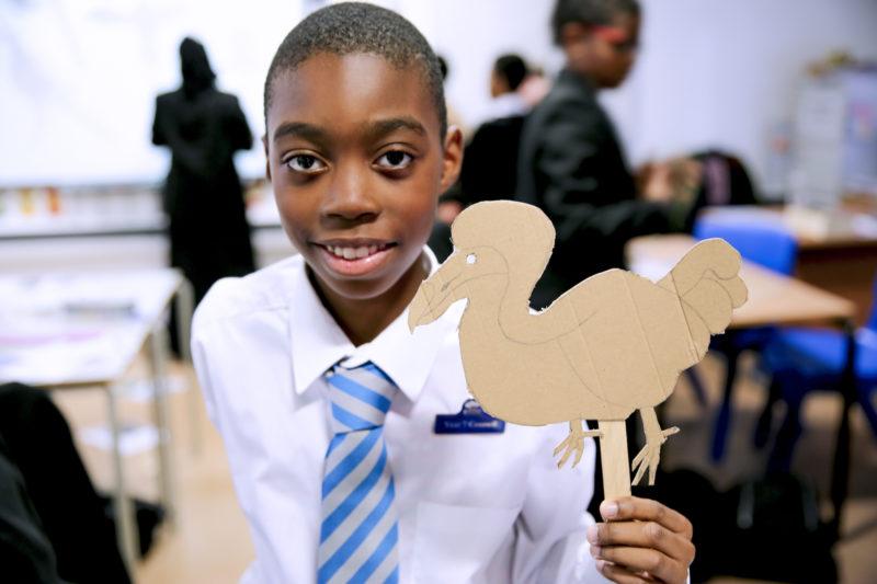 Woodside School boy with dodo puppet