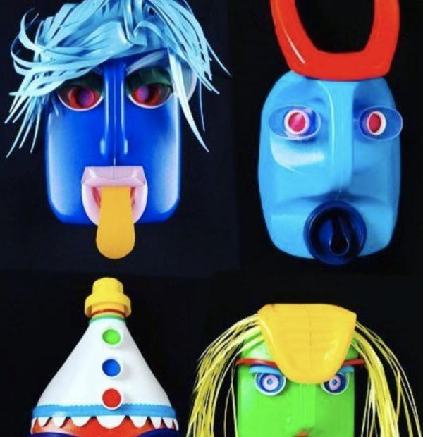 photo of four colourful masks on black background