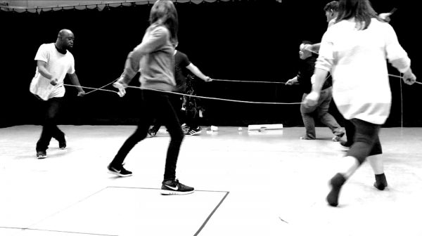 image of people playing together with elastic rope