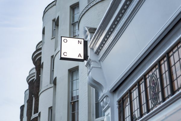 Lightbox sign on Georgian listed building that reads ONCA