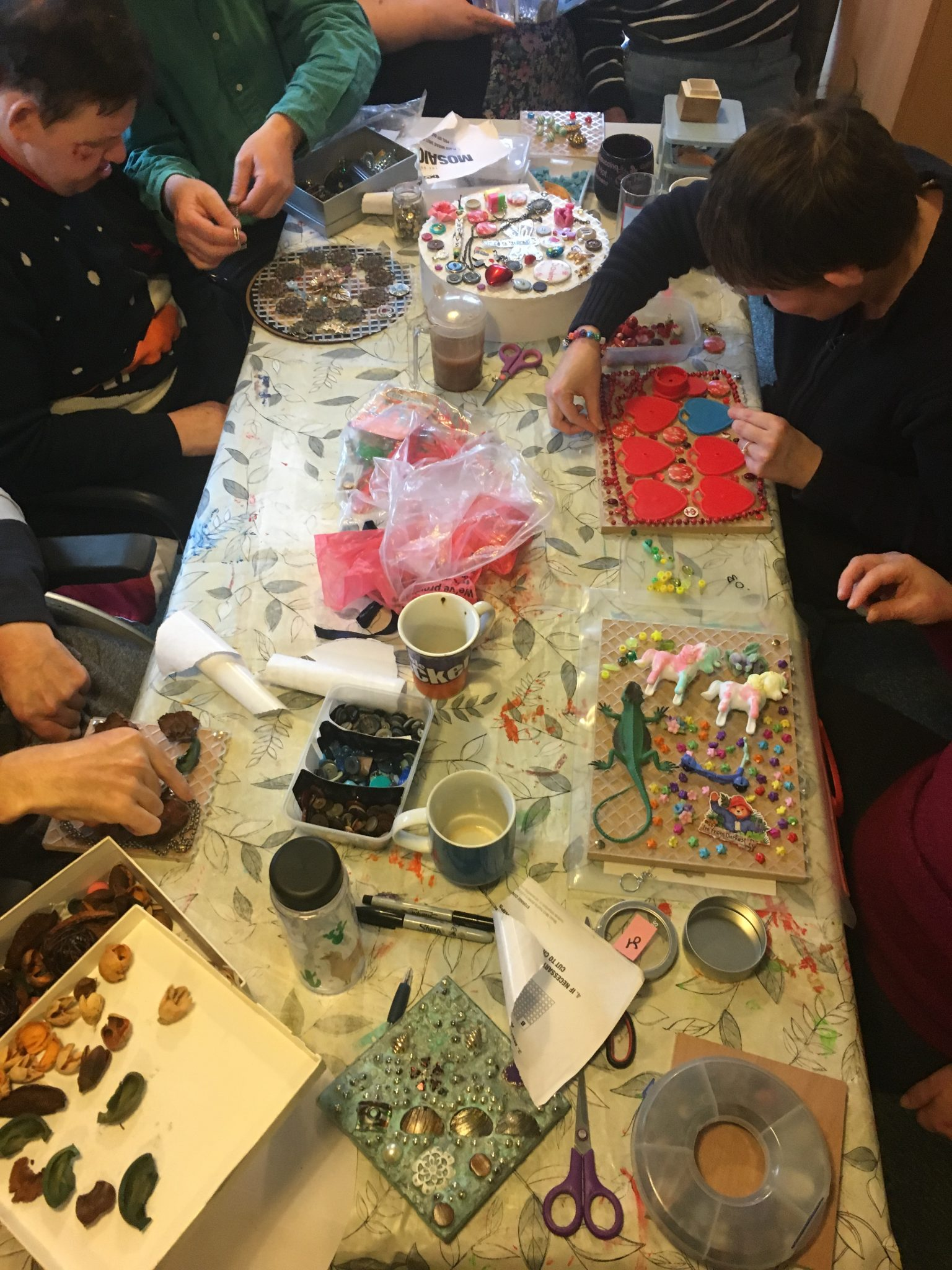 participants messily making art around a table