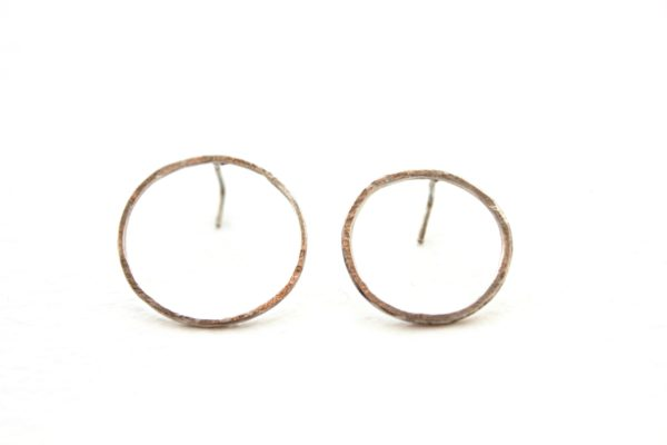 Gold circle metal earrings by Tricia Made
