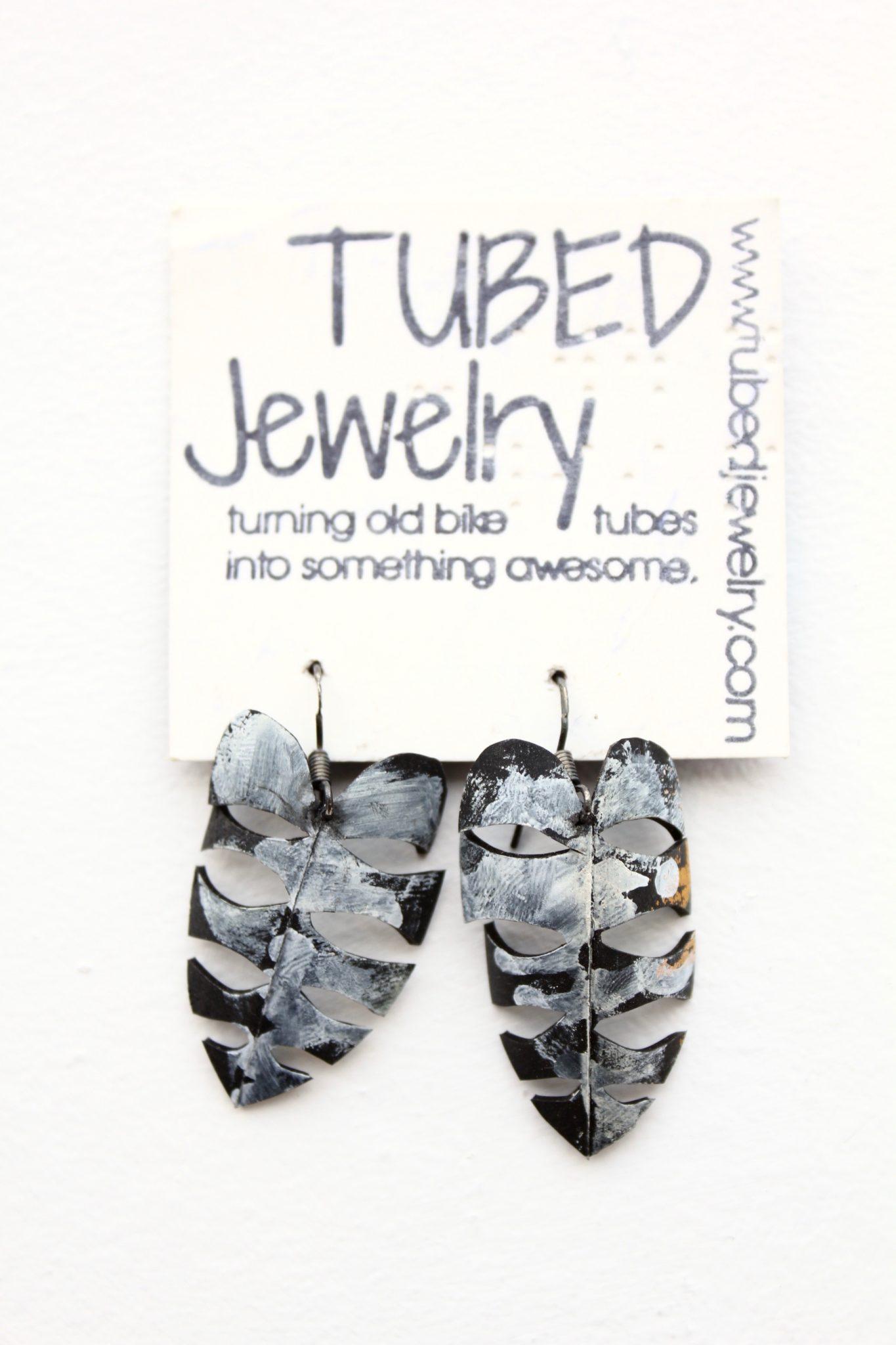 Fern-shaped upcycled bike tube earrings by Tubed Jewellery