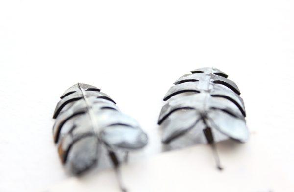 Detail of fern-shaped upcycled bike tube earrings by Tubed Jewellery