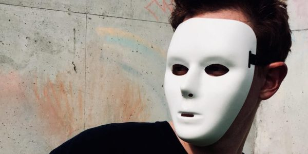 person in white mask
