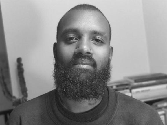 B&W photo of ONCA patron Josh Virasami
