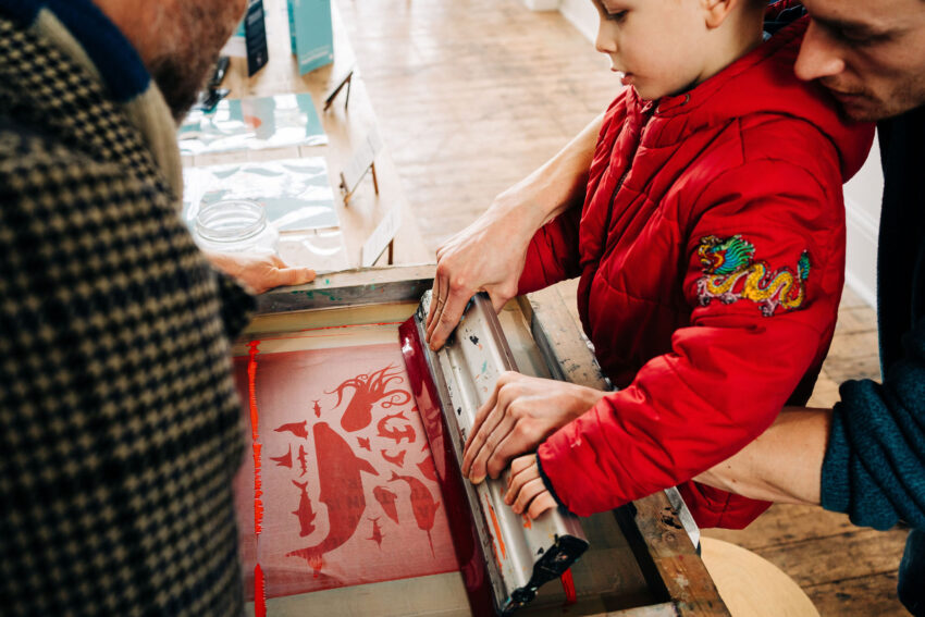 child doing screen printing
