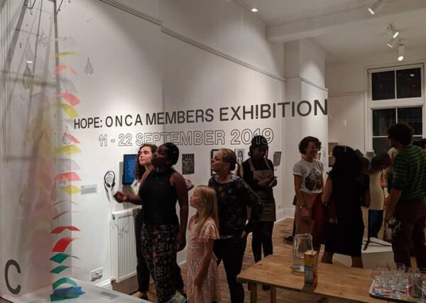 Crowd standing inside Exhibition