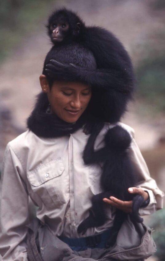 Tania 'Nena' Baltazar and two spider monkeys