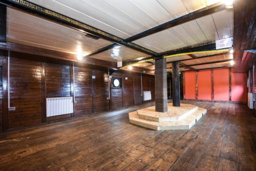 wood panelled lower deck of Barge