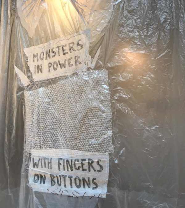 photo of installation with text by Beverly Naidus